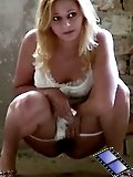 Blondie in white filmed while urinating