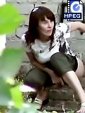 Outdoor spy cam movies of a peeing chick